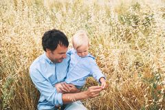 Happy father and son. Family outdoors together royalty free stock images