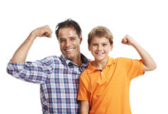 Happy father and son flexing their biceps Stock Image