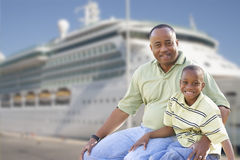 Happy Father and Son In Front of Cruise Ship Stock Image