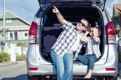 Happy father and son getting ready for road trip on a sunny day Royalty Free Stock Photography