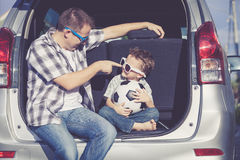 Happy father and son getting ready for road trip on a sunny day Stock Photography