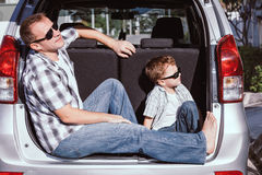 Happy father and son getting ready for road trip on a sunny day Royalty Free Stock Image