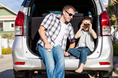 Happy father and son getting ready for road trip on a sunny day. Stock Photography