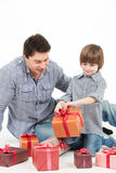 Happy father and son with gift box Royalty Free Stock Image