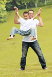 Happy father and son having fun Royalty Free Stock Images