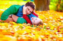Happy father and son having fun in autumn park Royalty Free Stock Photography