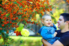Happy father and son having fun, colorful nature Stock Photography