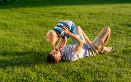 Happy father and son having fun outdoor on meadow Royalty Free Stock Photo