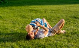 Happy father and son having fun outdoor on meadow Stock Image