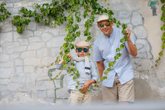 Happy father and son having fun outdoors in city Royalty Free Stock Image