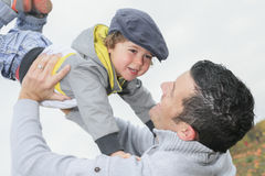 Happy father and son having fun throws up in the Stock Photo