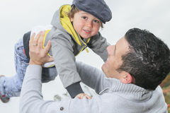 Happy father and son having fun throws up in the Royalty Free Stock Photography