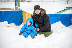 Happy father and son having fun under winter snow.  Royalty Free Stock Photo