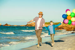 Happy father and son having great time on the Royalty Free Stock Photos