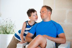 Happy father and son having rest outdoors on beautiful summer day Stock Photo