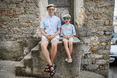 Happy father and son having rest outdoors in city Royalty Free Stock Photo