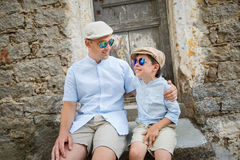 Happy father and son having rest outdoors in city Stock Photo