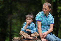 Happy father and son having rest outdoors in city Royalty Free Stock Image