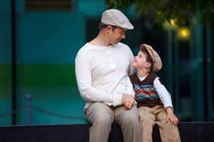 Happy father and son having rest outdoors Royalty Free Stock Image