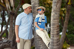 Happy father and son having rest outdoors Stock Images