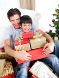 Happy father and son holding Christmas presents Stock Photography