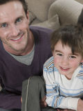 Happy Father And Son At Home Stock Photo