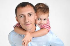 Happy father and son hugging on isolated white background. 