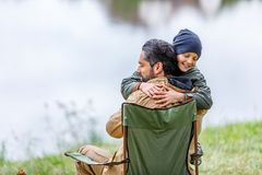 Father and son hugging at lake. Happy father and son hugging at lake Royalty Free Stock Photography
