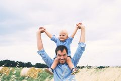 Happy father and son on nature at summer day. Family outdoors stock images