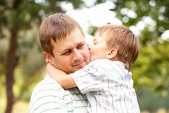 Happy father and son outdoors. Royalty Free Stock Images