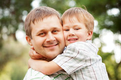 Happy father and son outdoors. Royalty Free Stock Photo