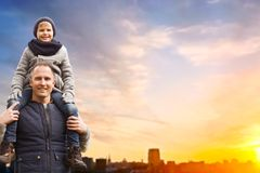 Happy father and son over sunset in tallinn city royalty free stock photos