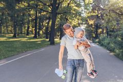 Happy father and son in the park royalty free stock photo