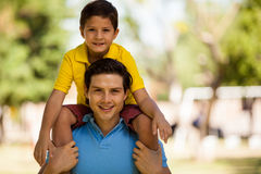 Happy father and son in a park Stock Image
