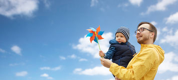 Happy father and son with pinwheel toy outdoors Royalty Free Stock Photos