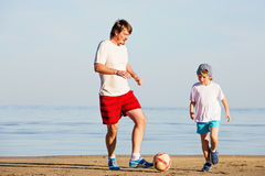 Happy father and son play soccer or football on Royalty Free Stock Image