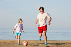 Happy father and son play soccer or football on Royalty Free Stock Images