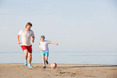 Happy father and son play soccer or football on Stock Photo