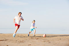 Happy father and son play soccer or football on Stock Images