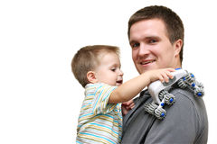 Happy father and son playing. Happy father holding the baby in him arms. Son is tow years old royalty free stock photos