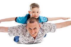 Happy father and son playing Royalty Free Stock Images