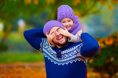 Happy father and son playing in autumn park Royalty Free Stock Photos