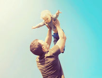 Happy father and son playing having fun together outdoors over sky royalty free stock photos