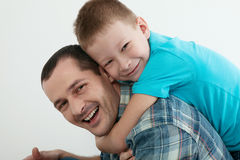 Happy father and son playing and laughing together at home. Family concept Royalty Free Stock Photography