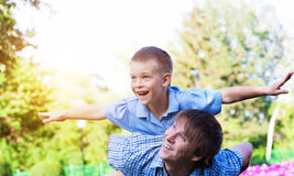 Happy father and son are playing in the park Royalty Free Stock Images