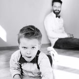 Happy father with son. Father and son are playing together Stock Images
