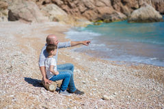 Happy father and son playing together at beach Royalty Free Stock Photos