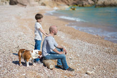 Happy father and son playing together at beach Royalty Free Stock Images