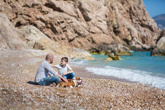 Happy father and son playing together at beach Royalty Free Stock Photo