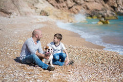 Happy father and son playing together at beach Royalty Free Stock Image